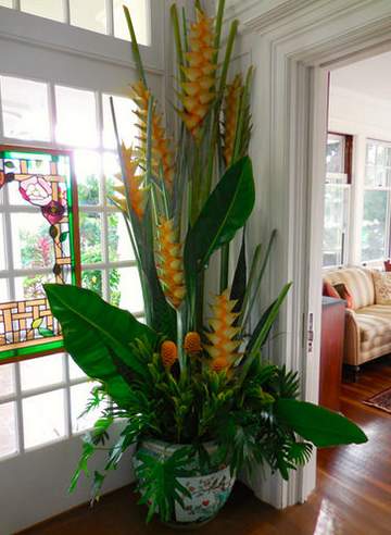 Yellow heliconia steal the show in this floor-to-ceiling arrangement.