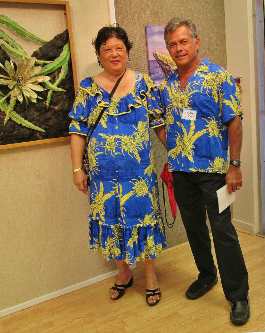 Gaye and Leighton with his artwork in the Alumni Art Exhibit.